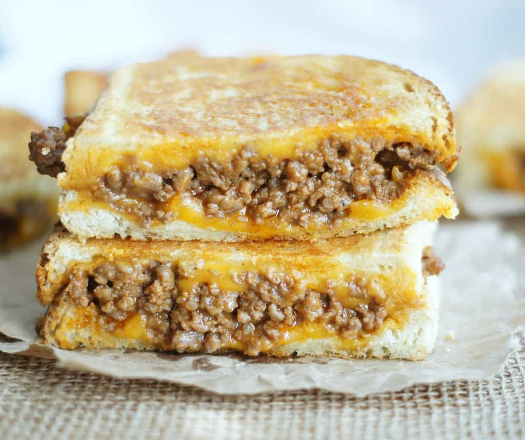 These Sloppy Joe Grilled Cheese Sandwiches are the UTLIMATE grilled cheese! With ooey-gooey melty cheese, and sloppy joe meat it's an easy to make dinner that is perfect for dinnertime.