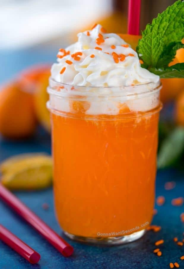 """You say """"creamsicle,"""" I say cocktail! This Creamsicle Drink recipe marries orange and vanilla cream in one sweet bubbly beverage that's sure to conjure happy memories of forgotten summer treats."""