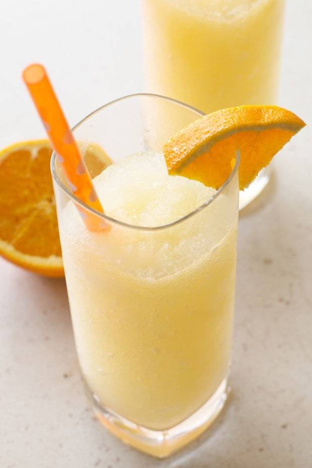 An Orange Dreamsicle cocktail is just the dreamy cocktail you need to dive into on a summery day. It tastes JUST like an orange creamsicle, and goes does just as easily so be careful before you inhale 4 or 5 of them!