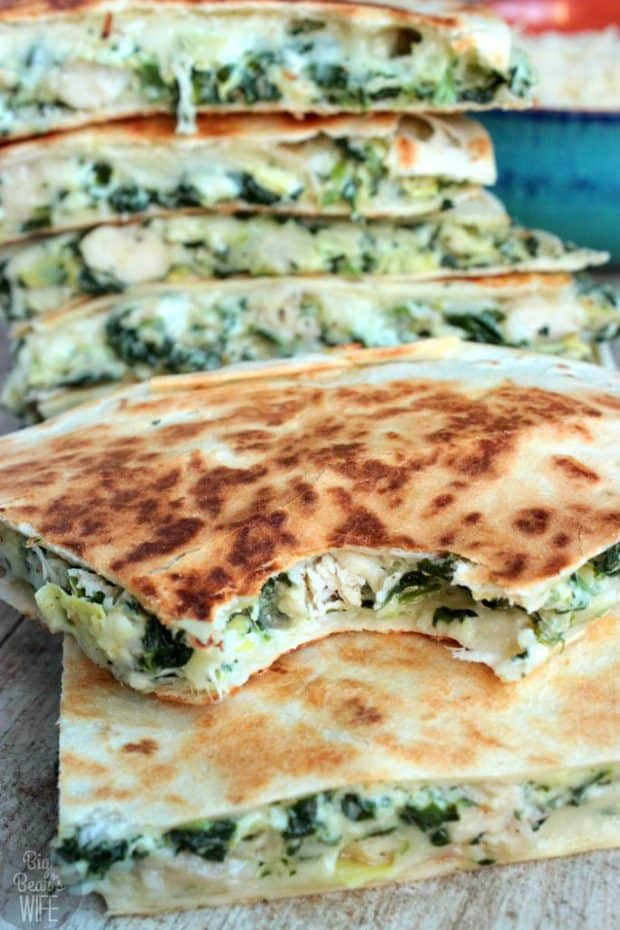 Spinach and Artichoke Chicken Quesadillas – homemade quesadillas stuffed with spinach and artichoke dip, seasoned chicken and melted cheese!