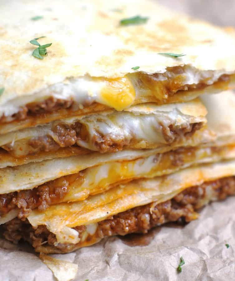 Simple, no-fuss quesadillas that are slightly crispy, totally cheesy and amazingly delicious!  These Cheesy Ground Beef Quesadillas are the perfect meal for busy weeknights!