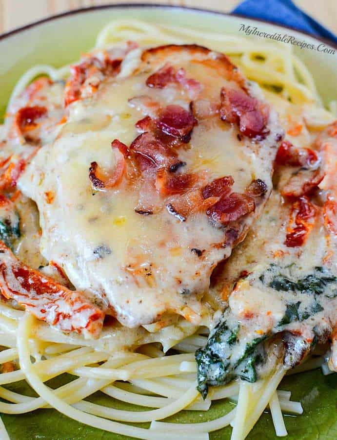 This Smothered Tuscan Garlic Chicken from My Incredible Recipes is everything you could possibly want for dinner! It's creamy, garlic-y, cheesy and oh-so delicious. Did we mention the bacon-y goodness on the top? Add in a few sun dried tomatoes, spinach and some pasta and dinner is ready — and super delicious too!