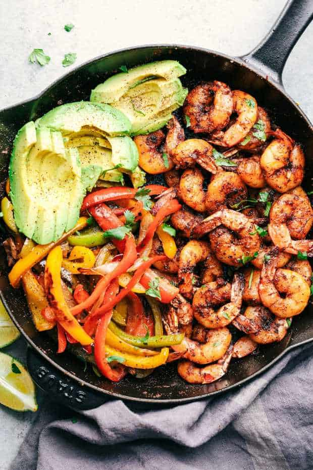 20 Minute Skillet Blackened Shrimp Fajitas are such an easy and flavorful meal packed with blackened shrimp, peppers and onion. This classic meal is perfect served up in tortillas with avocado and chopped cilantro!