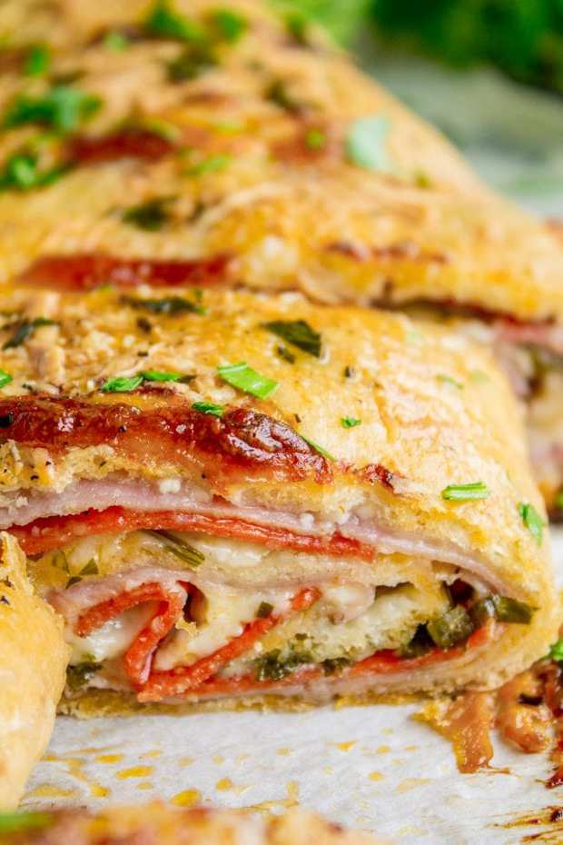 Stromboli is basically pizza that's been rolled up like a cinnamon roll. The classic ingredients include mozzarella, ham, and salami. I threw in some pepperoni and pepper jack cheese just for fun. It's so good dipped in marinara! Perfect quick dinner (that kids love) or appetizer for football-watching.