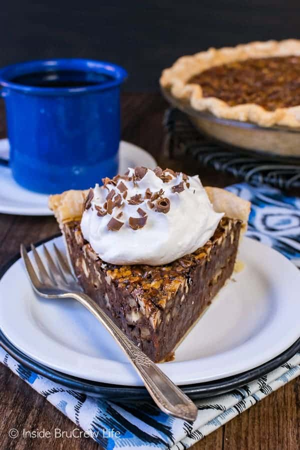 Add this Chocolate Fudge Pecan Pie to your Thanksgiving day dessert table this year. The gooey hot fudge layer and the toasted nuts will make this sweet treat a new favorite at Thanksgiving dinner.