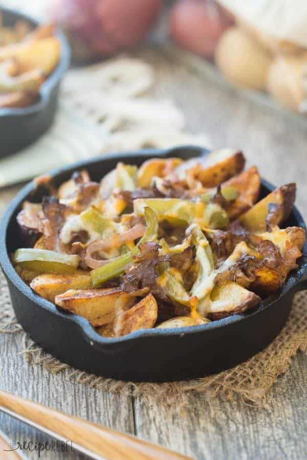 Seasoned crispy potato wedges topped with sauteed peppers, onions, roast beef and cheese — these Philly Cheesesteak Potato Wedges are the perfect appetizer (or meal in one!) for your next game day or get together!