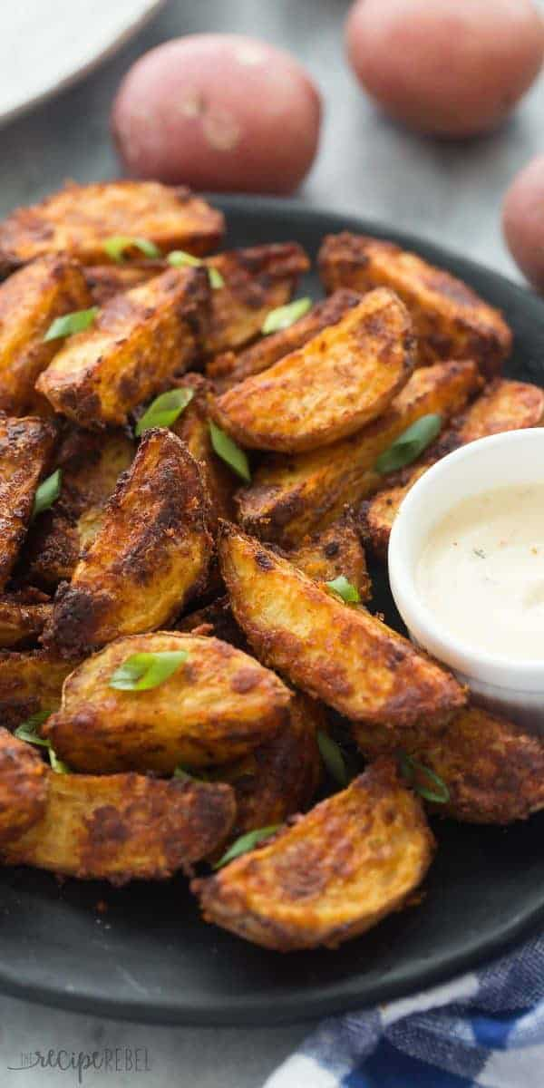 These Chipotle Parmesan Potato Wedges are so easy to make — just toss potatoes in some oil and spices, bake until crispy and serve! Perfect for a game day appetizer or dinner side dish!