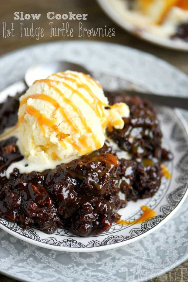 Fabulously gooey and outrageously delicious, these Slow Cooker Hot Fudge Turtle Brownies are going to rock your world! Hot fudge sauce, caramel, pecans, and gooey brownies come together for one irresistible dessert!