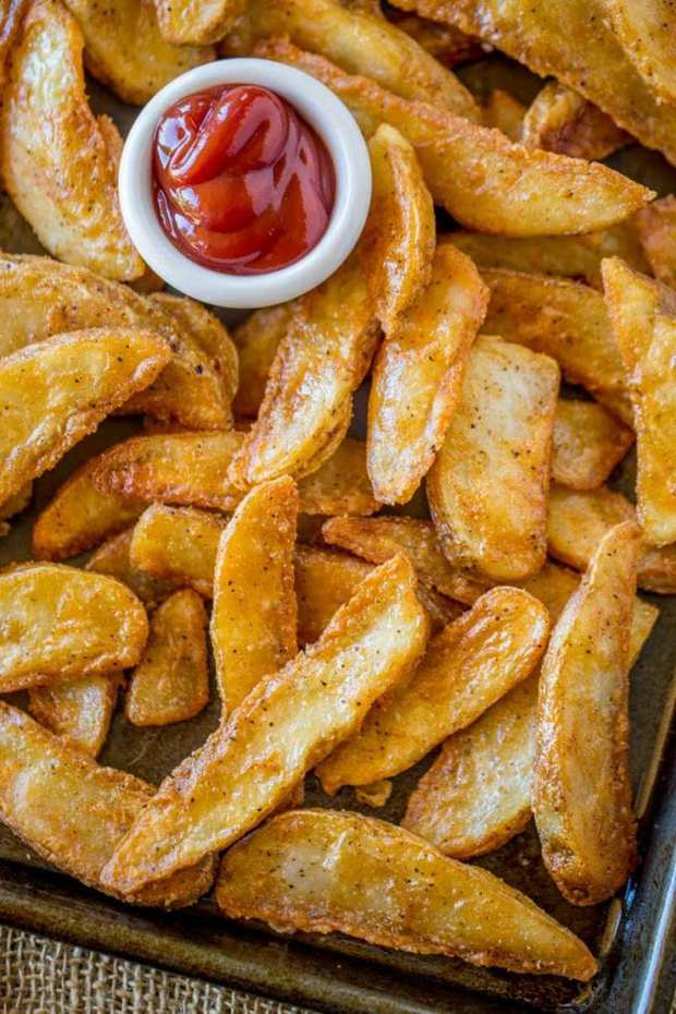 KFC Potato Wedges lightly battered in a thin KFC chicken flavored seasoning and double fried until super crispy on the outside and fluffy on the inside.