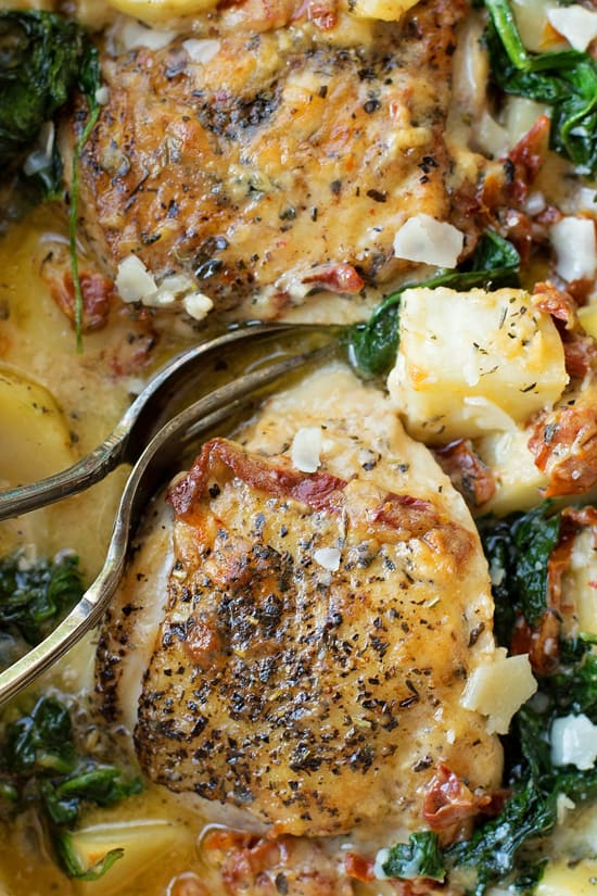 Crisp, herb roasted chicken with potatoes, spinach and sun-dried tomatoes, all in a garlic cream sauce. This tuscan-inspired meal is loaded with flavo
