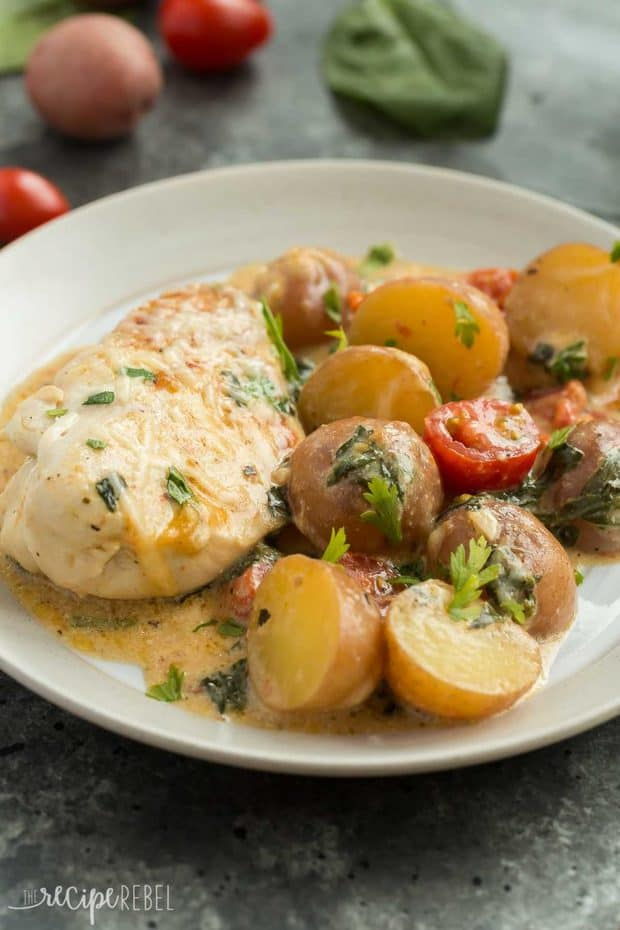 This One Pan Tuscan Chicken and Potato Skillet is an easy dinner idea that is loaded with flavor! With tomatoes, spinach, potatoes and a light Parmesan cream sauce, it's perfect one pot comfort food. Includes step by step recipe video.