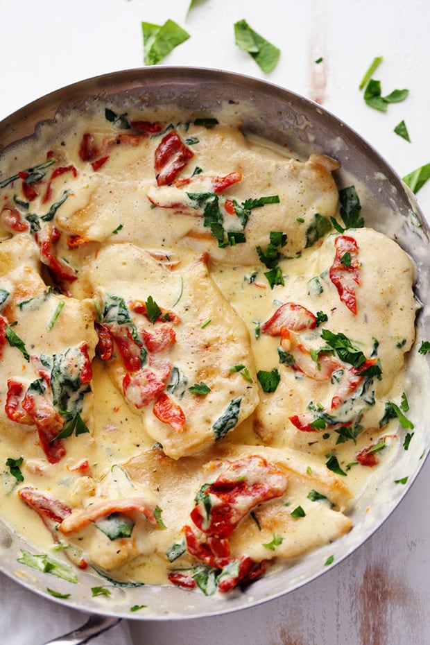Creamy Tuscan Garlic Chickenhas the most amazing creamy garlic sauce with spinach and sun dried tomatoes. This meal is a restaurant quality meal ready in 30 minutes!