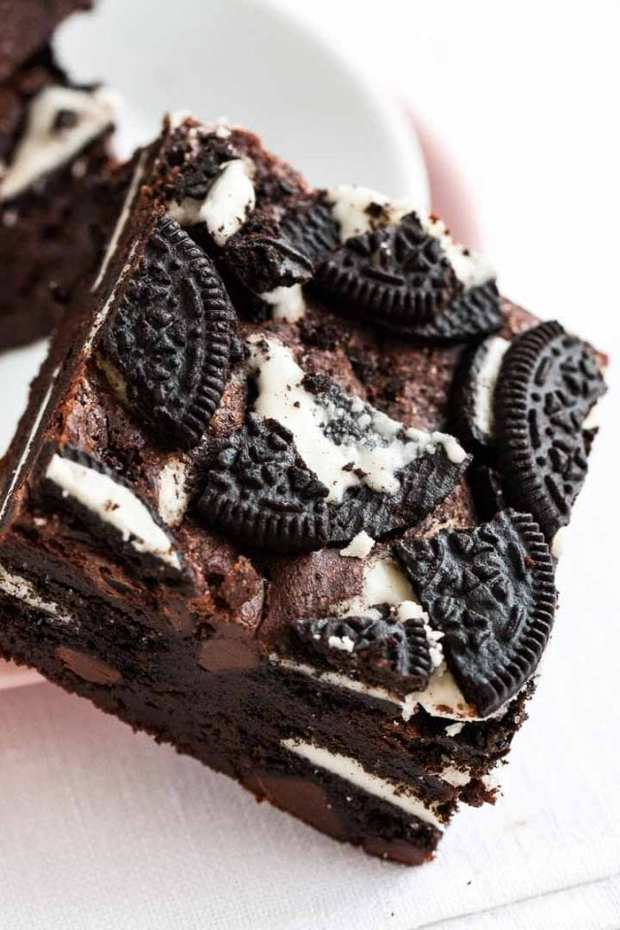 Oreo Brownies are fudgy, chocolatey, and out of this world delicious! A rich and chewy brownie recipe stuffed with Oreo cookies, topped with more crumbled cookies that is so easy to make from scratch and takes brownies to a whole new level of deliciousness.