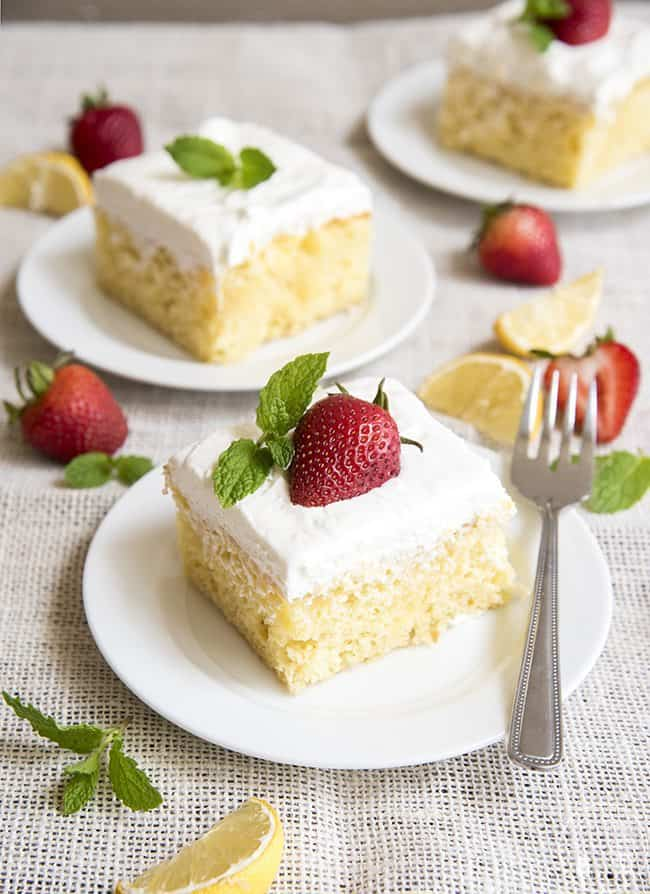 This lemon poke cake is perfectly refreshing. Its filled with lemon curd and topped with creamy whipped cream for the perfect spring or summer dessert!