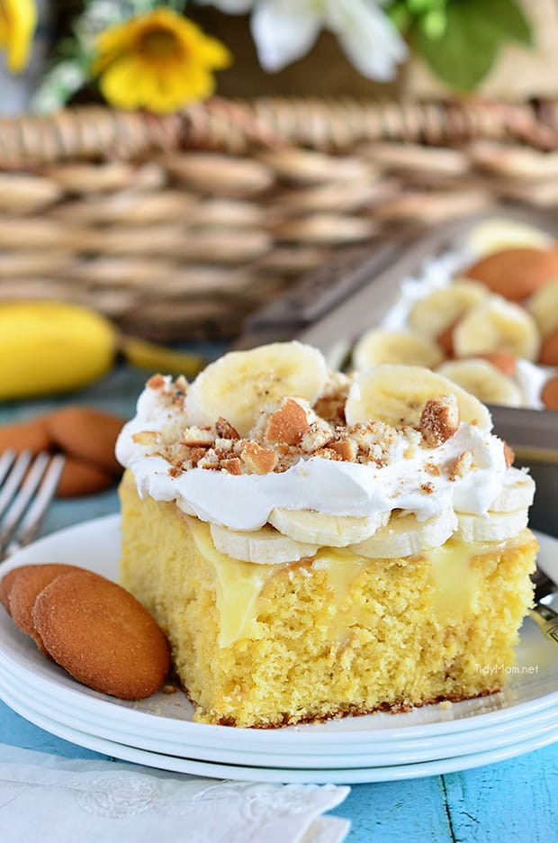 All the flavors you love in banana pudding come together in this Banana Pudding Poke Cake.  Trust me on this, this cake tastes every bit as good as it looks — it's hard to go wrong with banana pudding and vanilla wafers.