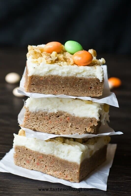 These 4 ingredient Carrot Cake Bars are made from a cake mix! They're good enough without frosting, but for a special treat top them with cream cheese frosting.