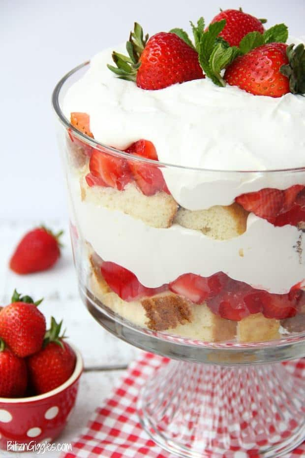Strawberry Shortcake Trifle – A beautiful and delicious trifle layered with vanilla cake, homemade strawberry glaze and cream! Such a pretty dessert!