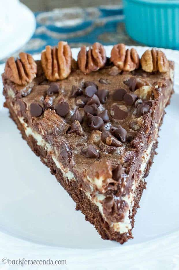 the perfect mixture of all your favorite desserts! It has rich pecan pie layer surrounded by chocolaty brownies and filled with a cheesecake center that makes this dessert a little slice of heaven!