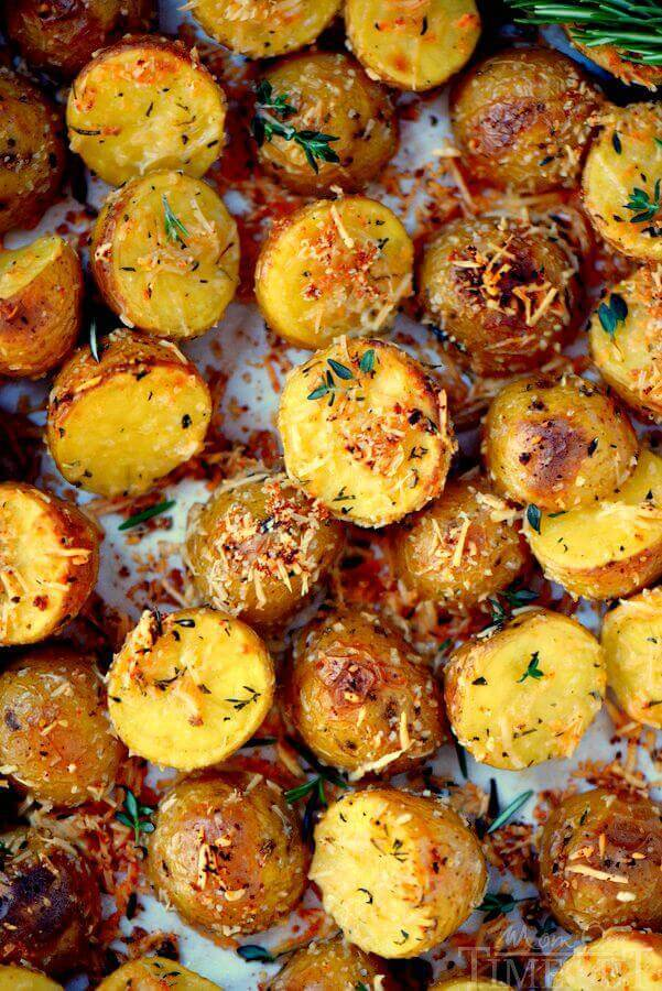 Oven Roasted Herb and Garlic Parmesan Potatoes are the perfect side dish to whatever you're making for dinner tonight! Perfectly crispy on the outside and light and fluffy on the inside!
