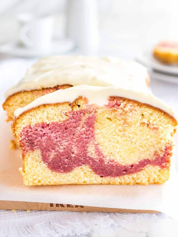 Copycat Starbucks Raspberry Swirl Pound Cake is so easy to make from scratch and is topped with a delicious cream cheese frosting. Raspberry and Lemon batters are swirled together to make a perfect summer treat!