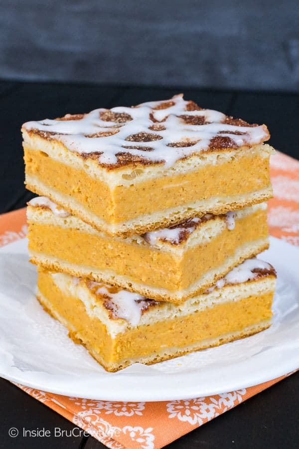A cinnamon sugar coating and a sweet glaze gives this Churro Pumpkin Pie Cheesecake Danish a fun and pretty texture!  It's the perfect way to add pumpkin to your breakfast routine this fall!
