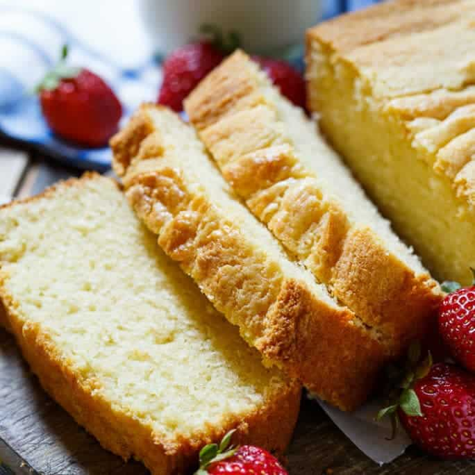 Condensed Milk Pound Cake is a buttery, rich, and dense pound cake sweetened with sweetened condensed milk. Topped with whipped cream and fresh berries, it makes a delightful summer dessert.