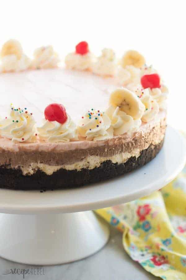 3 fruity cheesecake layers make up this easy, No-Bake Banana Split Cheesecake: banana pineapple, strawberry and chocolate! The perfect summer dessert!