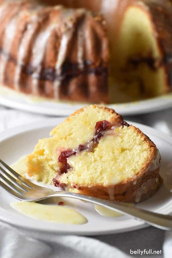 This cranberry orange pound cake is rich and buttery, with a layer of cranberry sauce inside, and a bright orange glaze. Perfect flavor combination and festive for the holidays!