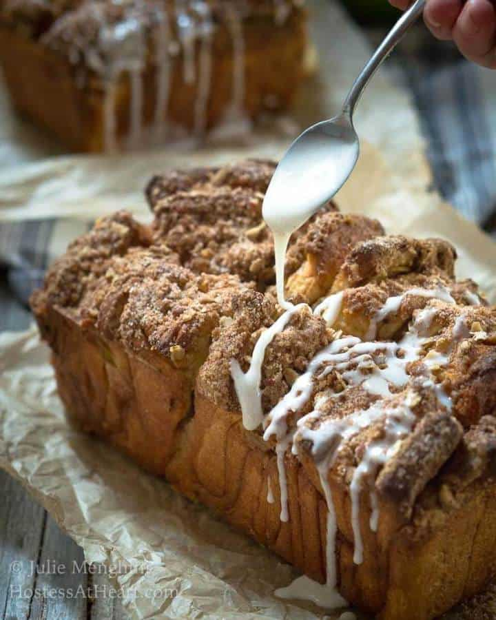 Apple pecan streusel pull apart bread makes a delicious addition to your breakfast or with a cup of soup. It's a no-fuss way to get the taste of cinnamon roll without all of the work.