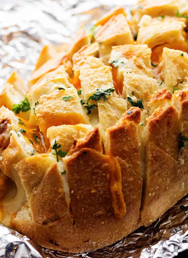 An amazing pull apart bread stuffed with three cheeses and a buttery garlic! You won't be able to get enough!