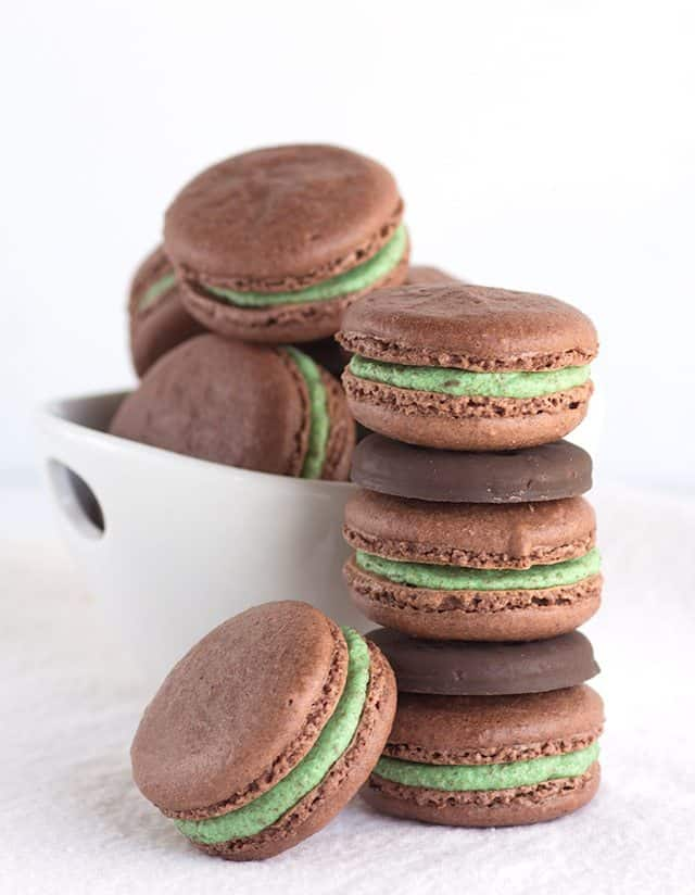 Macaroons!! These thin mint chocolate macarons have thin mint crumbs all through them. When I say crumbs, I don't mean eat the entire pack and dump the leftover crumbs into the batter. We're going to pull out our food processor and give an entire roll of cookies a good blitz.
