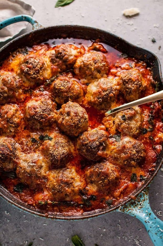 Hello cheesy baked meatball skillet of your dreams! Tender and flavorful meatballs, a rich tomato sauce, and plenty of melted cheese make this skillet recipe a winner