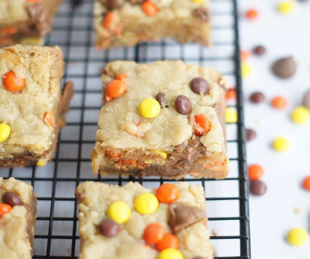 """Are you a Reese's Pieces lover? I am (surprise, surprise), so when I spied this recipe on Instagram the other day, I jumped on the chance to make them. These are so good and so simple to make. Depending on how long you cook them, they can be gooey in the center or more """"well-done"""". I prefer mine on the gooey side in case you couldn't tell from the pictures."""