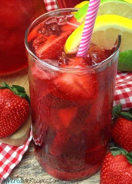 Southern Strawberry Sweet Tea is made with real strawberries and its sure to be an instant HIT in your house!