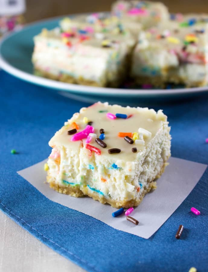 So, yeah, these Funfetti Cheesecake Squares are showcasing some serious bling.  More importantly though, they're packing some serious flavor.  All in one bite you get the taste of cake batter, that creamy cheesecake texture, buttery, crunchy cookie crust, and sprinkles