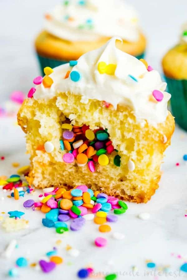 Who doesn't love aFunfetti Cupcake? These light and fluffy Funfetti Cupcakes use a doctored up cake mix and are filled with a fun surprise!