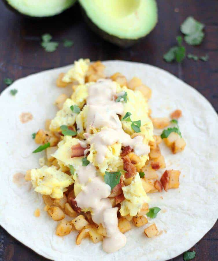 Perfect for breakfast, lunch, or dinner, the warm queso totally takes these breakfast tacos to a whole new level. Your family will LOVE them!