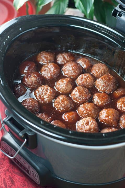 TheseSlow Cooker Grape Jelly BBQ Cocktail MeatballsfromWishes and Dishesis an awesome recipe for entertaining! They are so simple to make and extremely crowd pleasing!