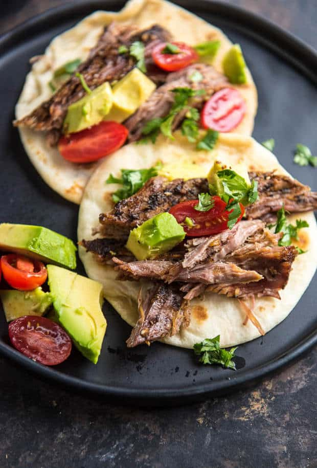 This Slow Cooker Carne Asada from Slow Cooker Gourmet is a simple way to make delicious tacos any night of the week! This tender delicious beef has just the right seasonings!