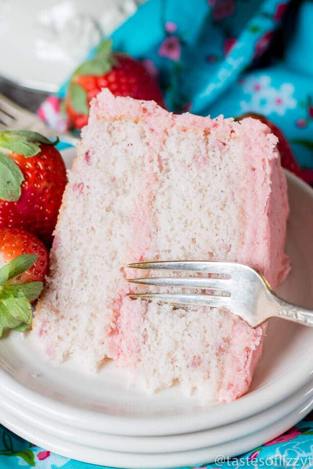 Hints for the perfect Homemade Strawberry Cake! This 100% from-scratch recipe uses fresh strawberries in the cake and in the homemade buttercream.
