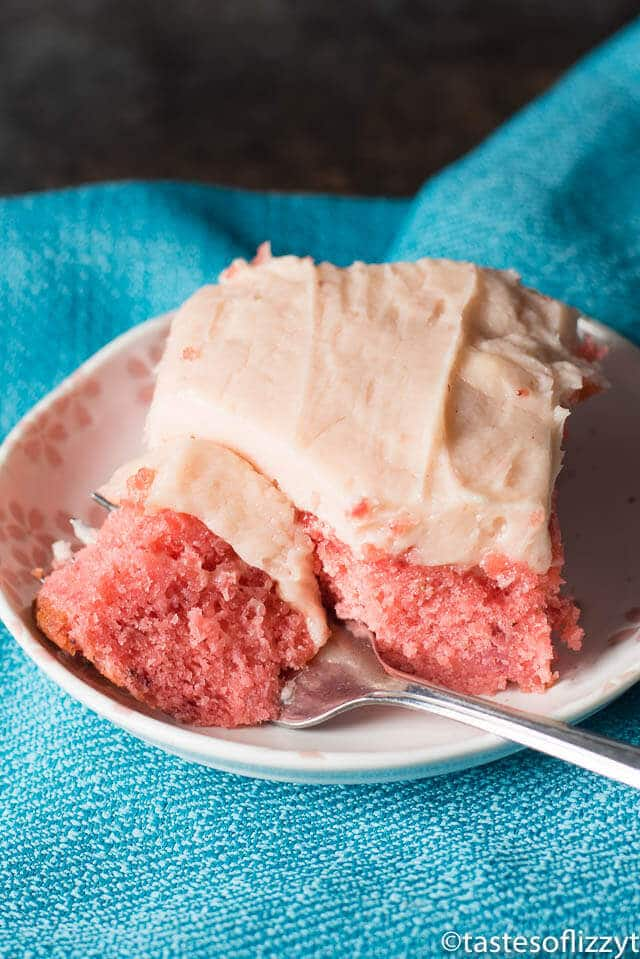 If you're looking for an easy strawberry cake recipe, this is it! This extra-moist cake starts with a boxed cake mix, but is anything from ordinary. Top with homemade strawberry frosting that tastes like a milkshake.