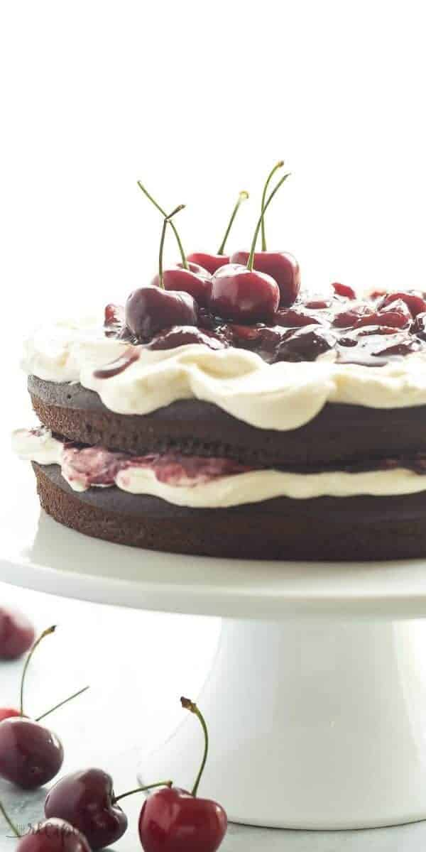 Black Forest Cake is SO EASY and naturally gluten free — and no gluten lover would ever know the difference! Chocolate Cake is layered with real whipped cream and homemade cherry sauce!