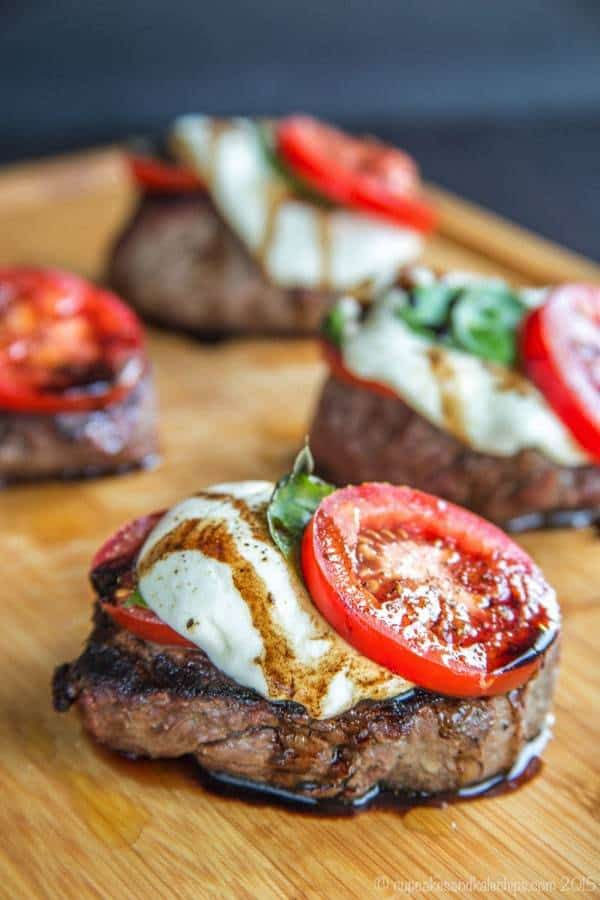 Add summer flair to grilled steak by topping those filets with the classic salad of tomatoes, fresh mozzarella, and basil.