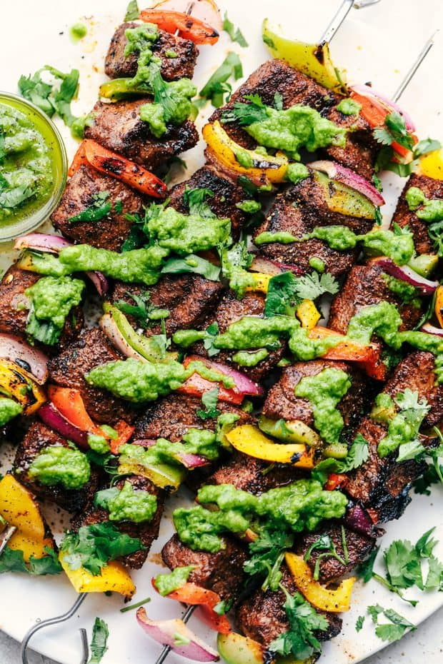 Grilled Steak Fajita Skewers with Avocado Chimichurri are perfectly seasoned tender and juicy steak skewers with bell peppers. The Avocado Chimichurri is the perfect dipping sauce to these skewers making the best summer meal!