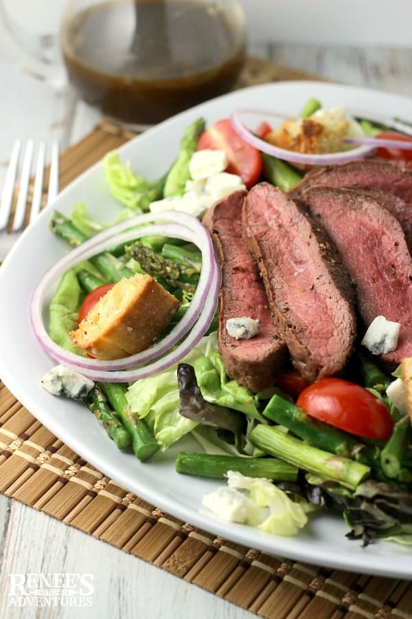 There's nothing more delicious than a good steak salad and this absolutely delicious Grilled Steak, Asparagus, and Blue Cheese Salad fits the bill!  Such a winning combination. You'll want to put this quick and easy recipe on your spring menu soon!