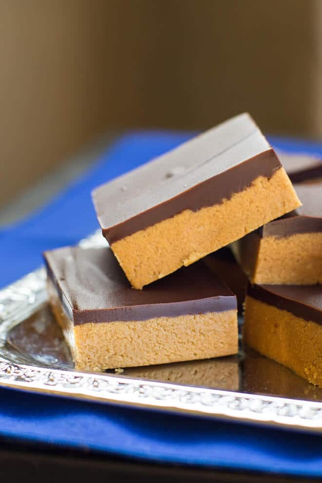 "No Bake Peanut Butter Bars take only 5 ingredients and 10 minutes (plus chilling time). My Grandma calls them ""Almost Reese's"" for good reason!"