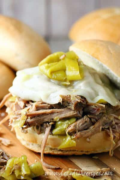 TheseSlow Cooker Pepperoncini Beef SandwichesfromLet's Dishare one of those meals that are super easy to make with just a handful of ingredients. Slow cooked shredded beef with spicy pepperoncini and Italian seasonings, topped with cheese and served on crusty rolls!
