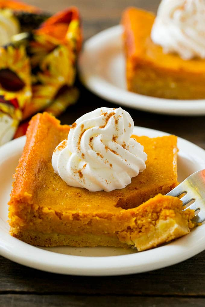 This Pumpkin Gooey Butter Cake is rich, decadent and incredibly delicious - you must make this! It's the perfect end to any fall meal.
