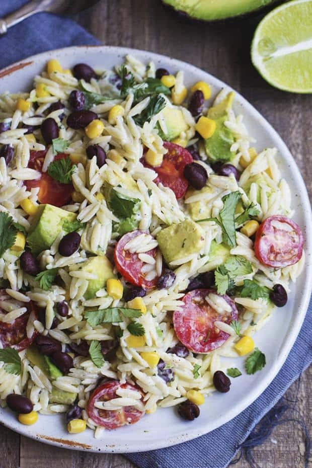 Orzo pasta that is filled with corn, black beans, cilantro, avocado and cherry tomatoes.  The cilantro lime ranch dressing on top is incredible!