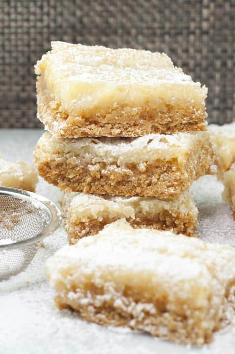 "Ooey Gooey Butter Cake Bars dessert recipe, also known as ""Chess Squares"" or ""Chess Cake Bars"" are easy, rich, and truly addictive!  Butter makes everything better!"